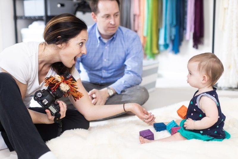 atlanta newborn photographer plays with child