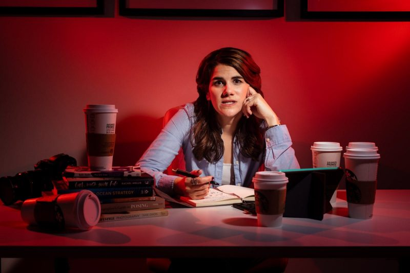 female freelancer working over desk with coffee
