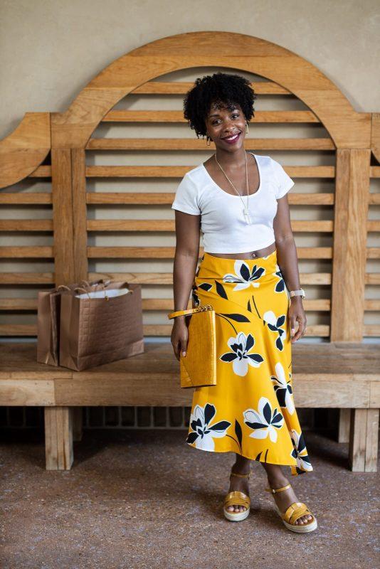 atlanta fashion blogger poses at avalon for on location portrait