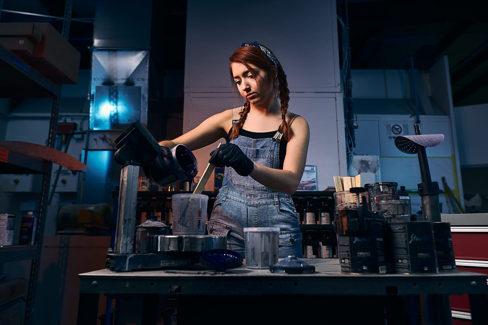 girl mixes automotive paint at atlanta bodyshop