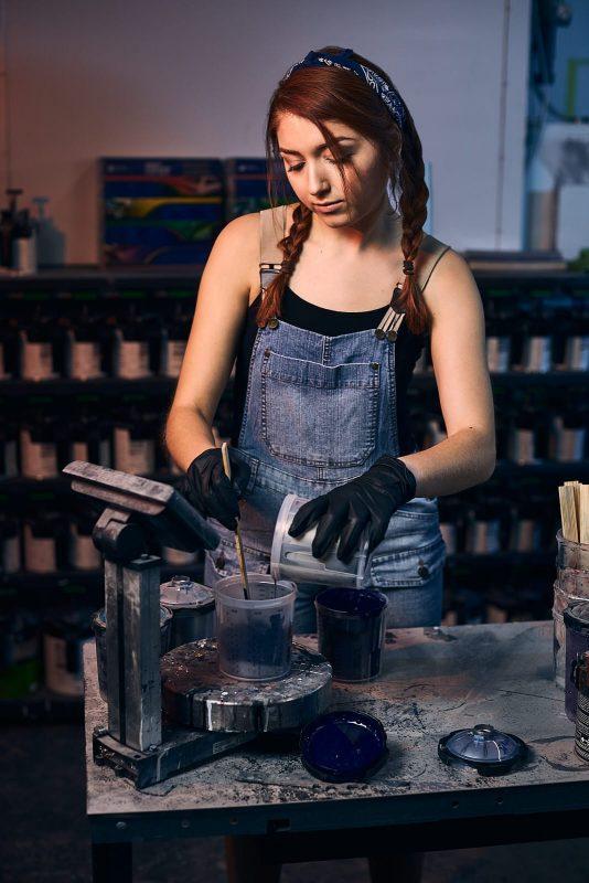 creative portrait of atlanta girl mixing paint