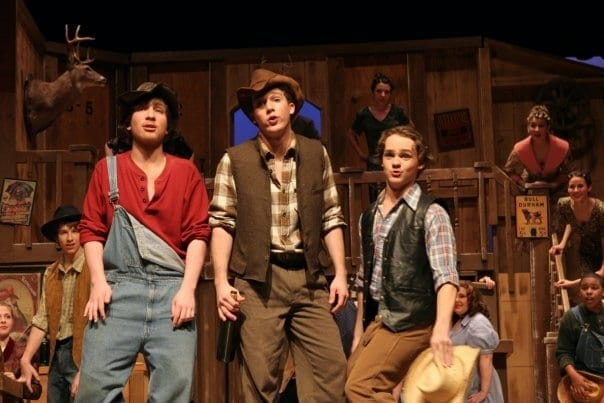 High School theater performance of Crazy For You Cowboy Trio