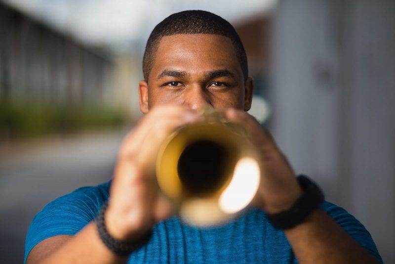 jazz musician plays saxophone in east midtown atlanta