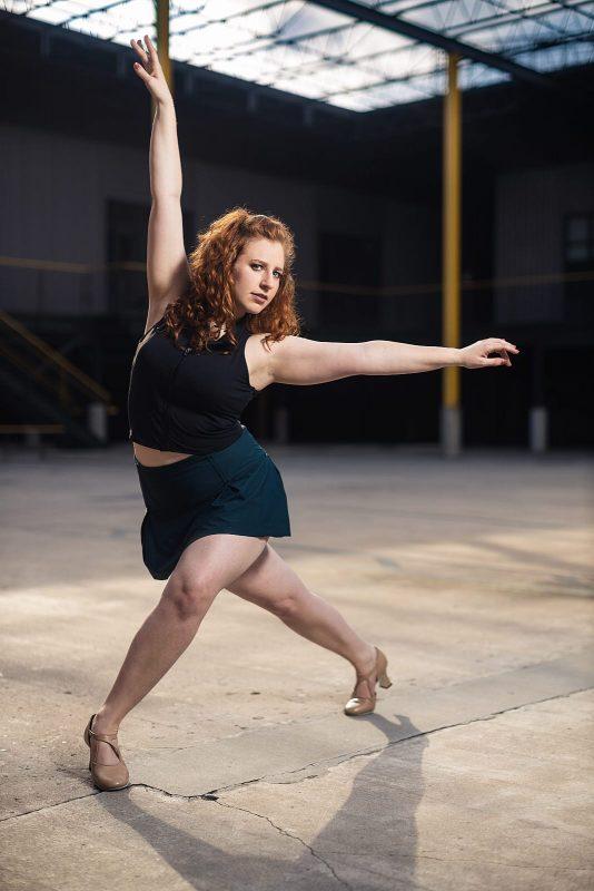 ballet dancer poses in industrial park
