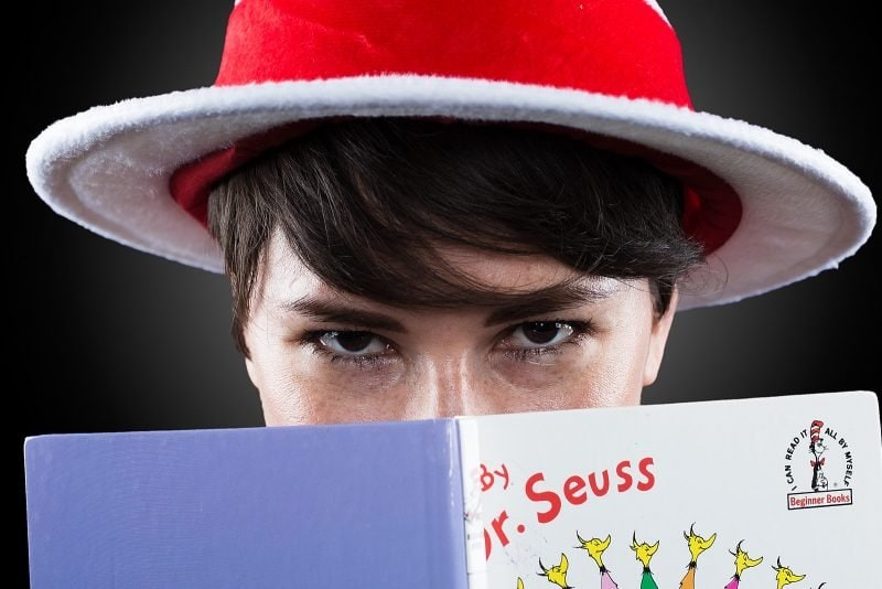 cat in the hat looks over dr seuss book