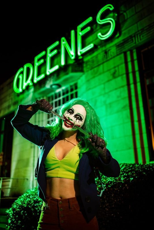 female joker cosplay with knives