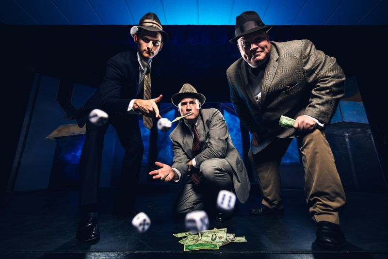 creative flash portrait of mobsters gambling with dice