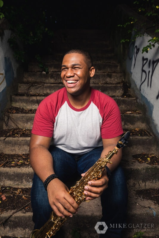musician brings props to portrait session