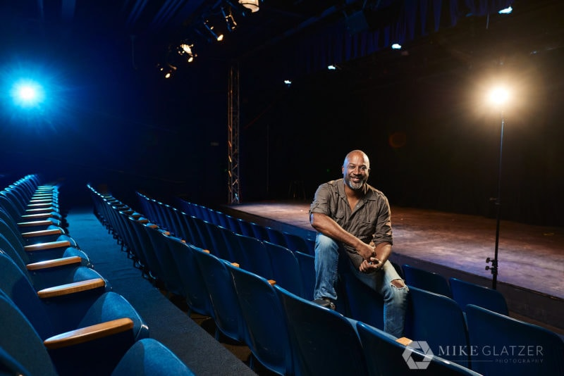 black director seated in theater