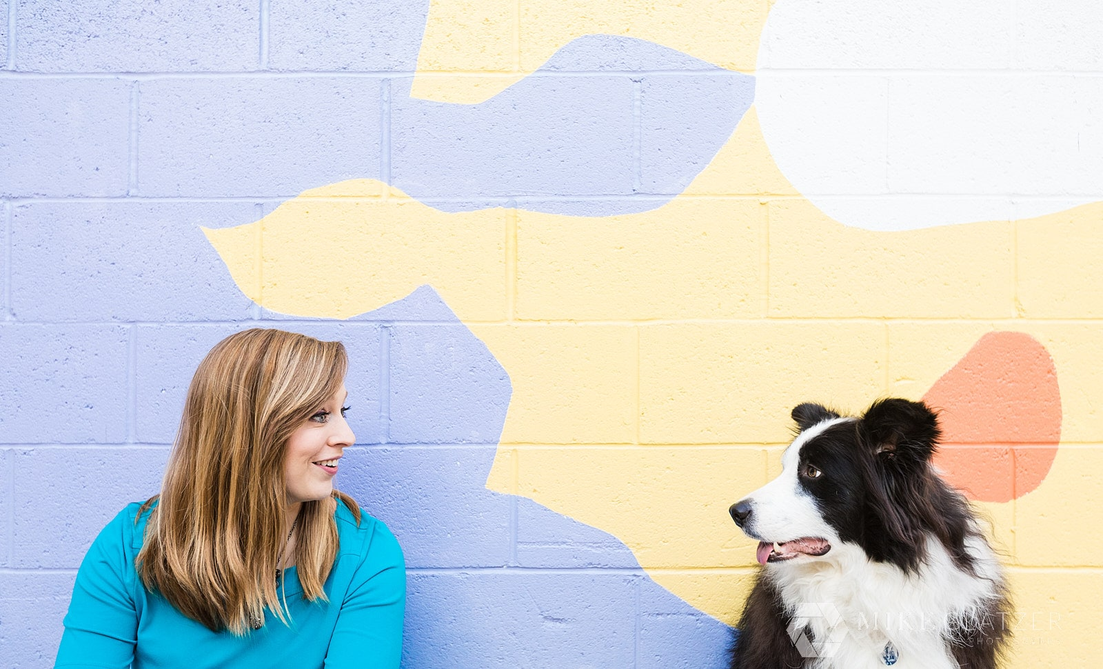 dog trainer wears bright colors for brand shoot