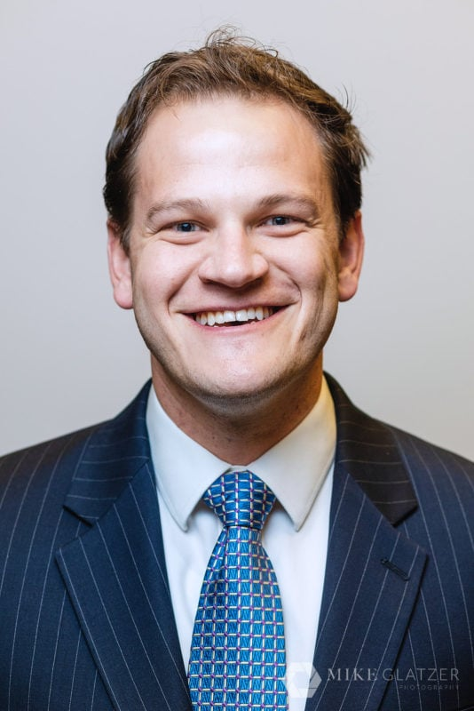 lawyer headshot with dark blue suit colors