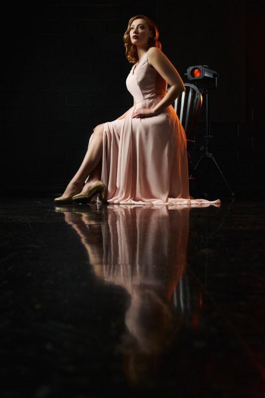 classic hollywood creative senior portrait of girl sitting on chair