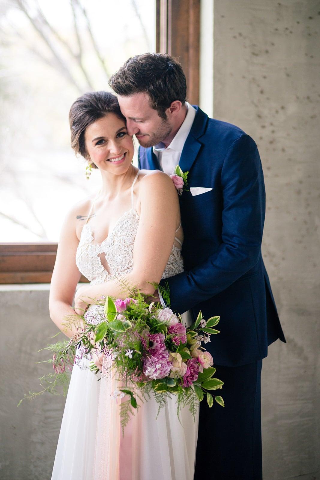 bride and groom snuggle Summerour Studio Atlanta