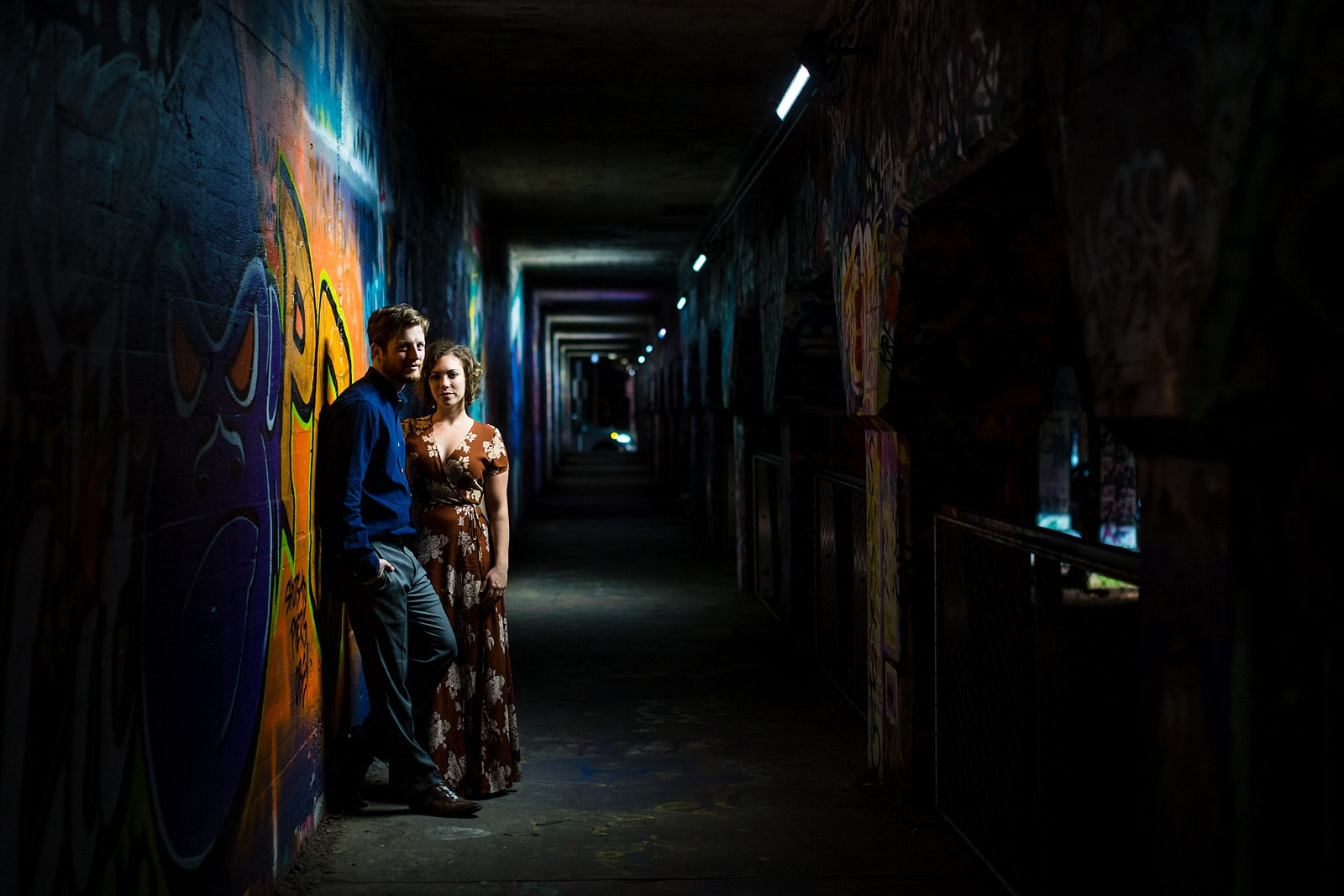 engaged couple poses at Krog Street Tunnel Atlanta