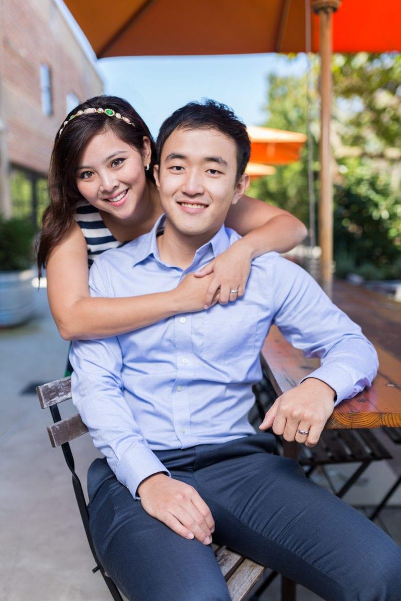 engaged couple smiles at Atlanta Westside Provisions engagement