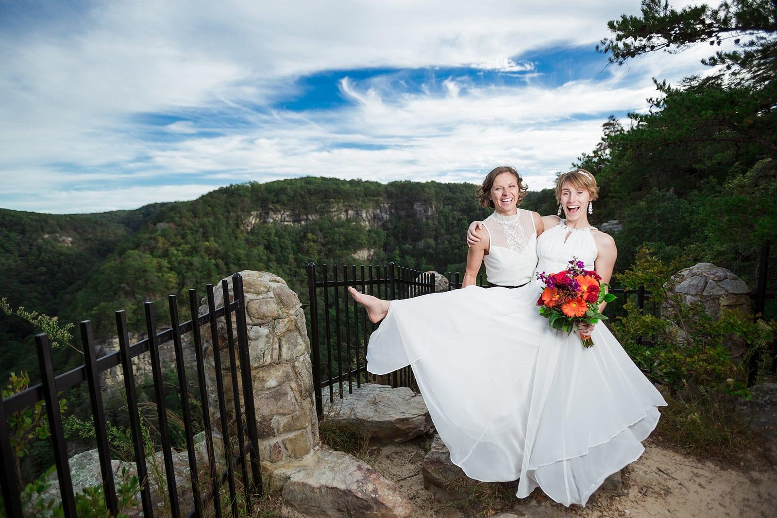 lesbian wedding couple smiling at Cloudland Canyon