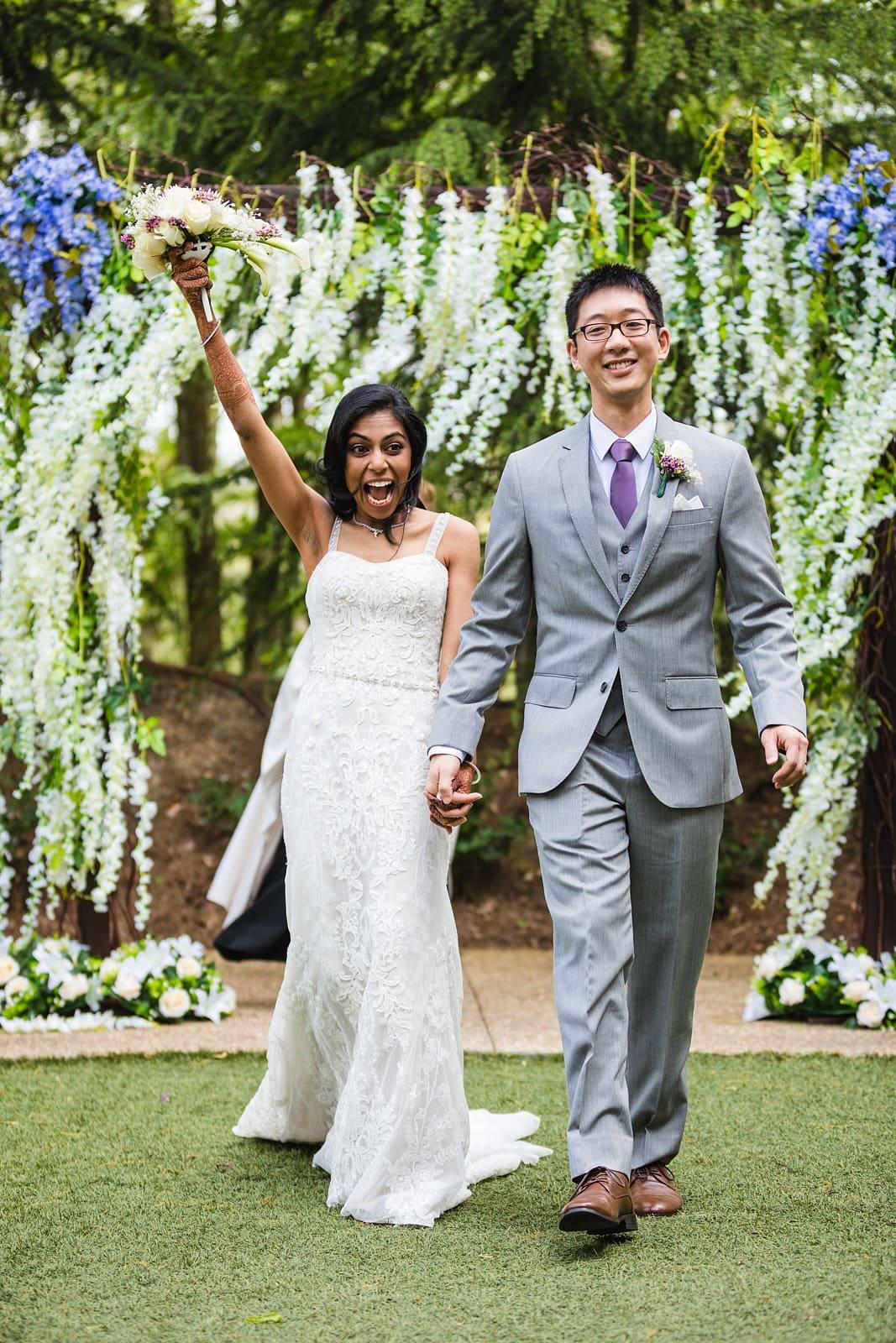 Atlanta wedding ceremony exit bride smiles