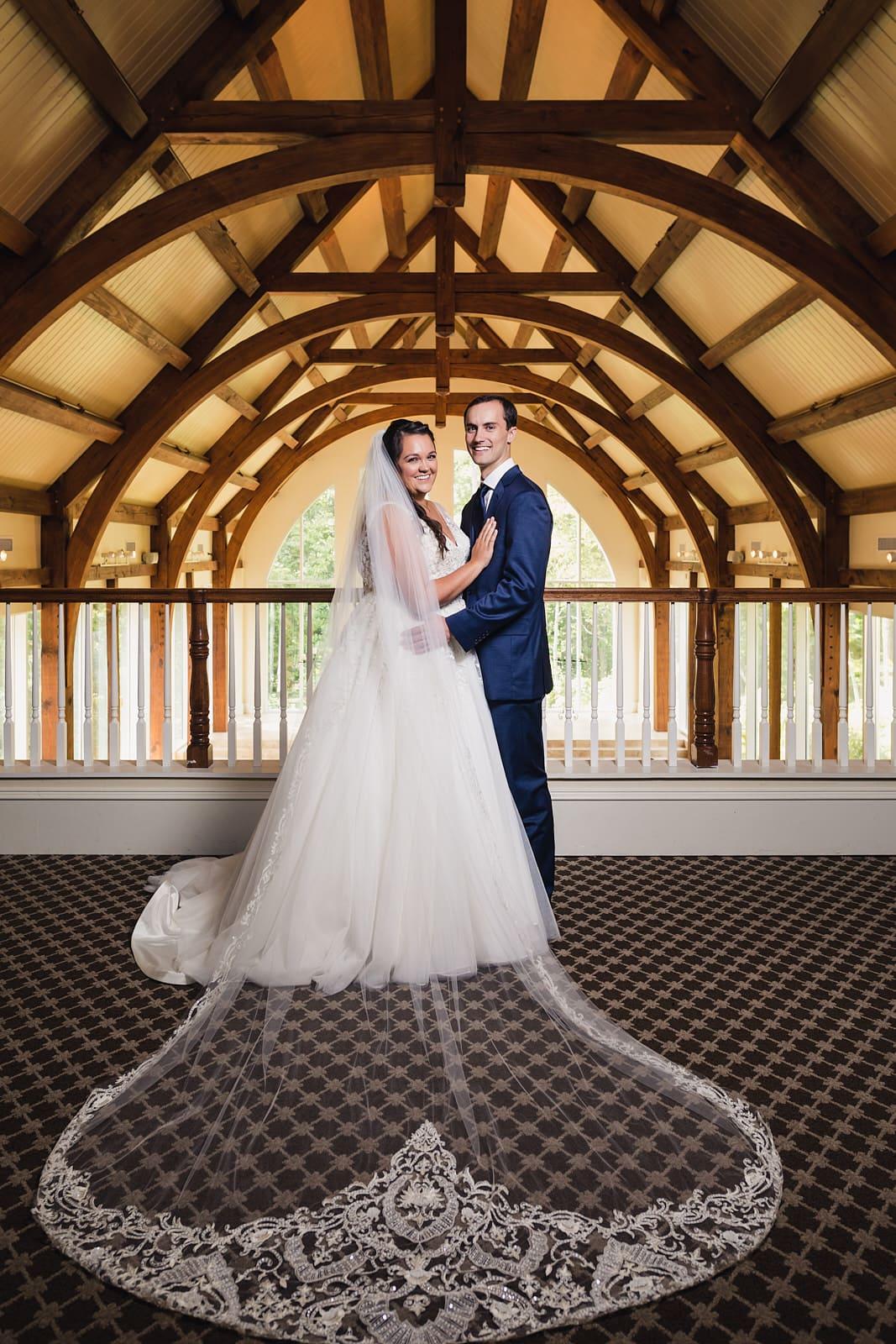 bride and groom pose at Ashton gardens Atlanta wedding venue