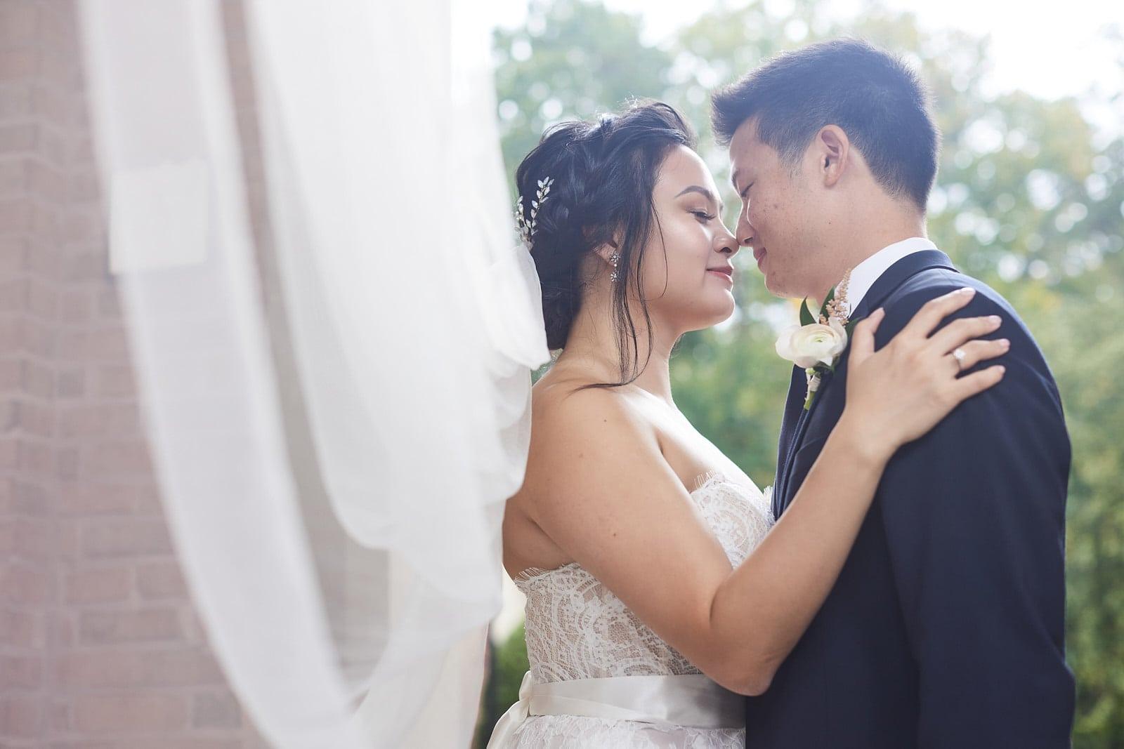 bride and groom hug with long veil atlanta wedding