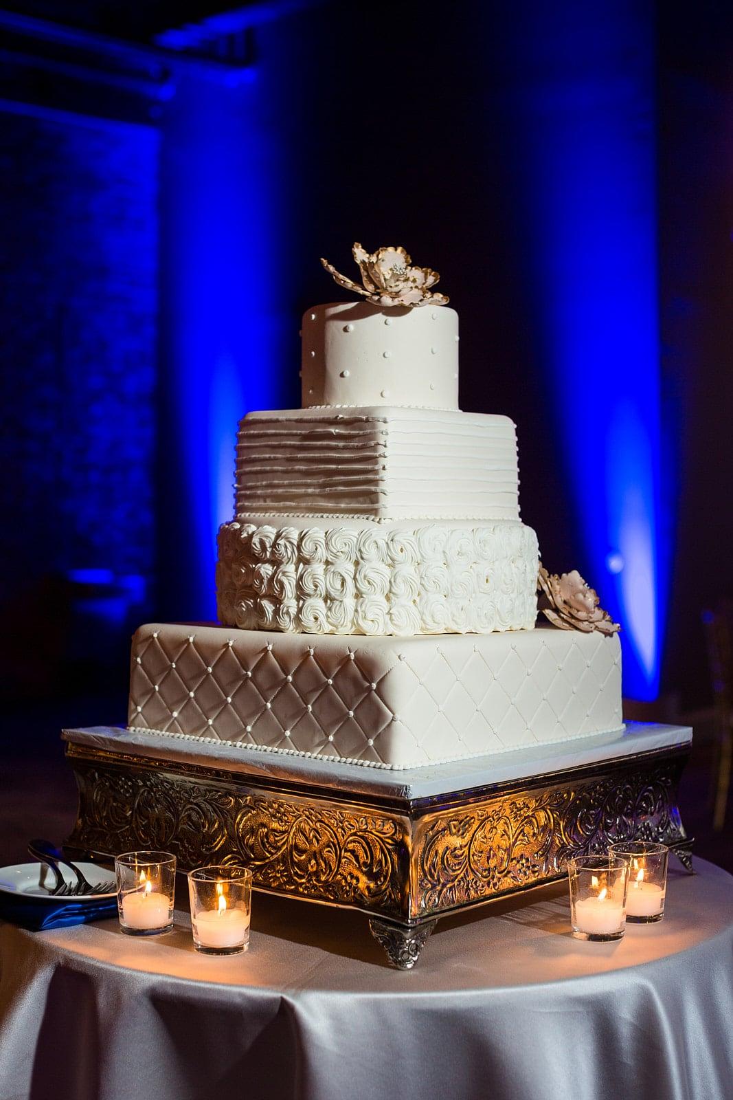 Atlanta wedding cake with blue uplighting