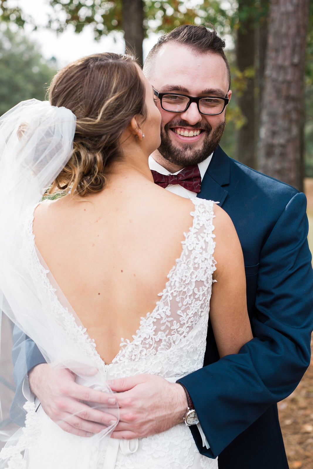 bride kisses groom on cheek at Little River Farms wedding