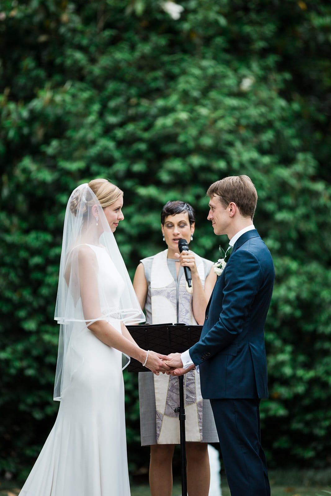 Atlanta wedding ceremony bride and groom exchange vows at Agnes Scott College