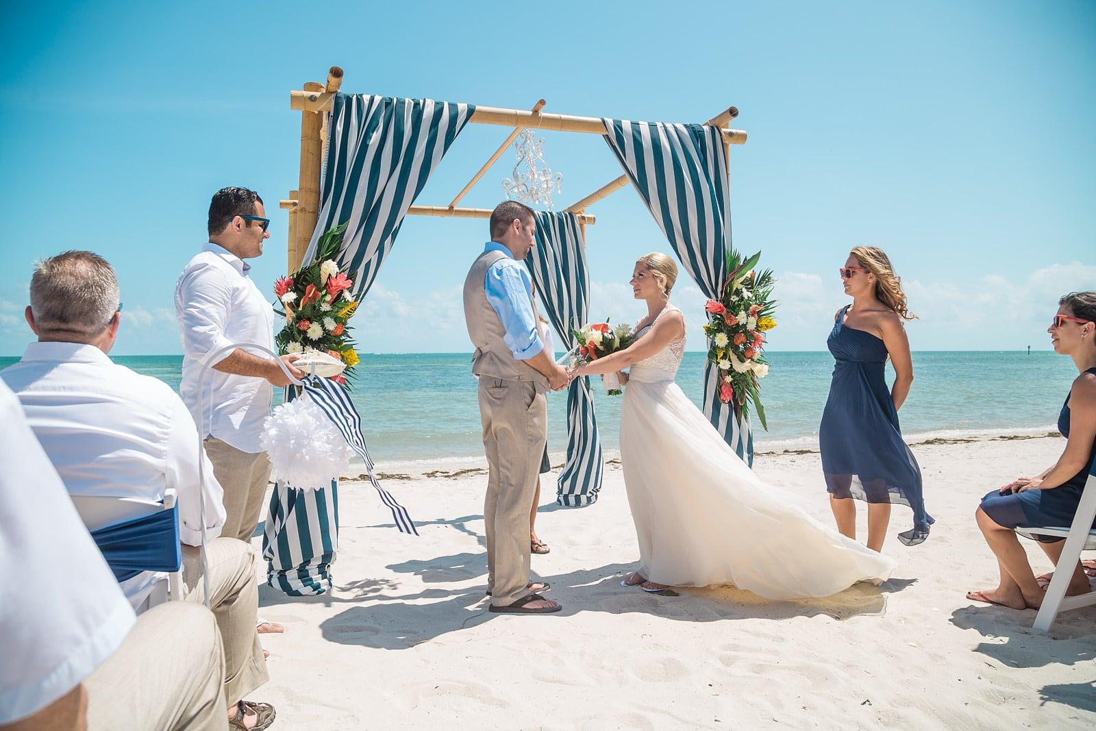 bride and groom exchange vows florida beach ceremony