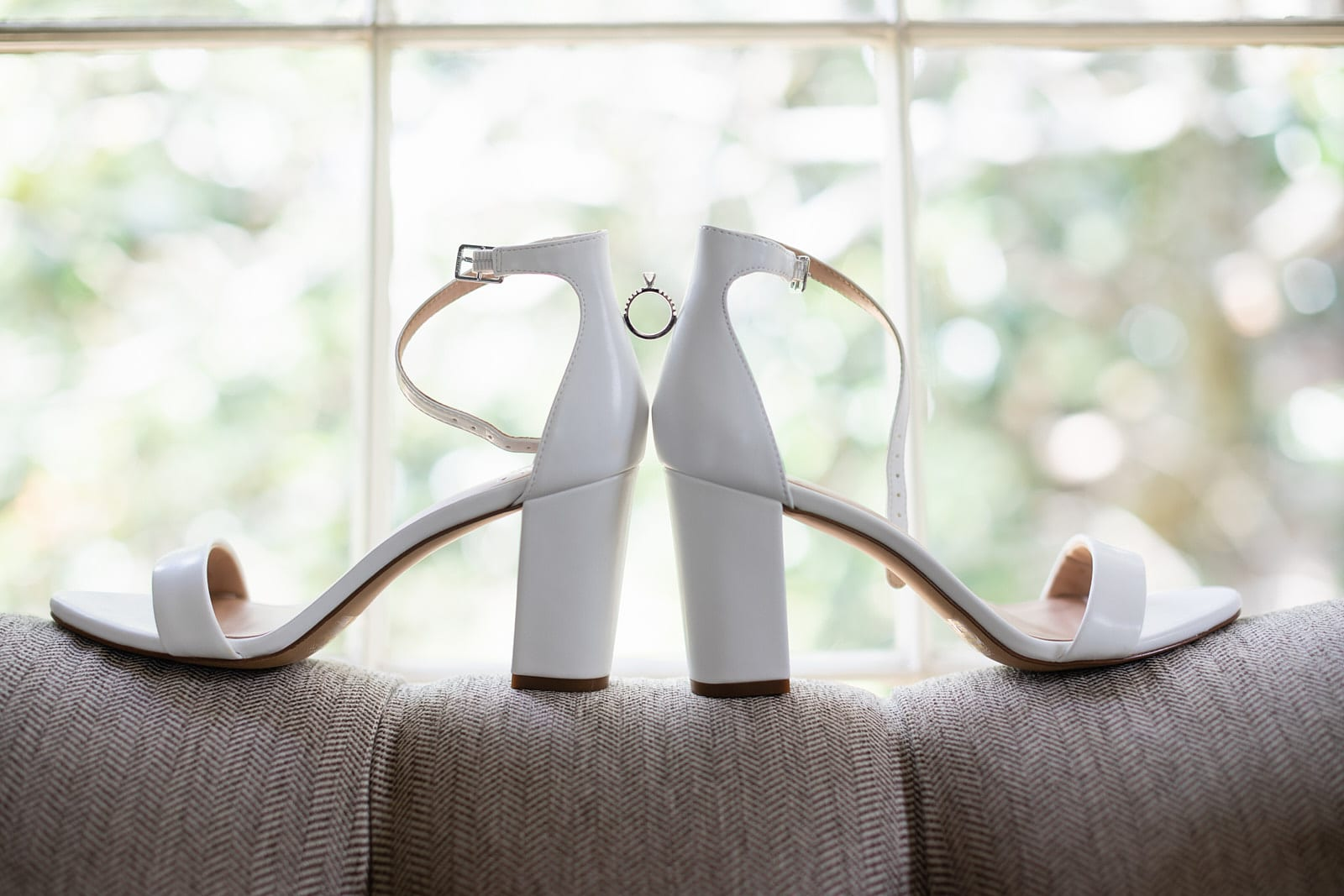wedding ring placed on bride shoes